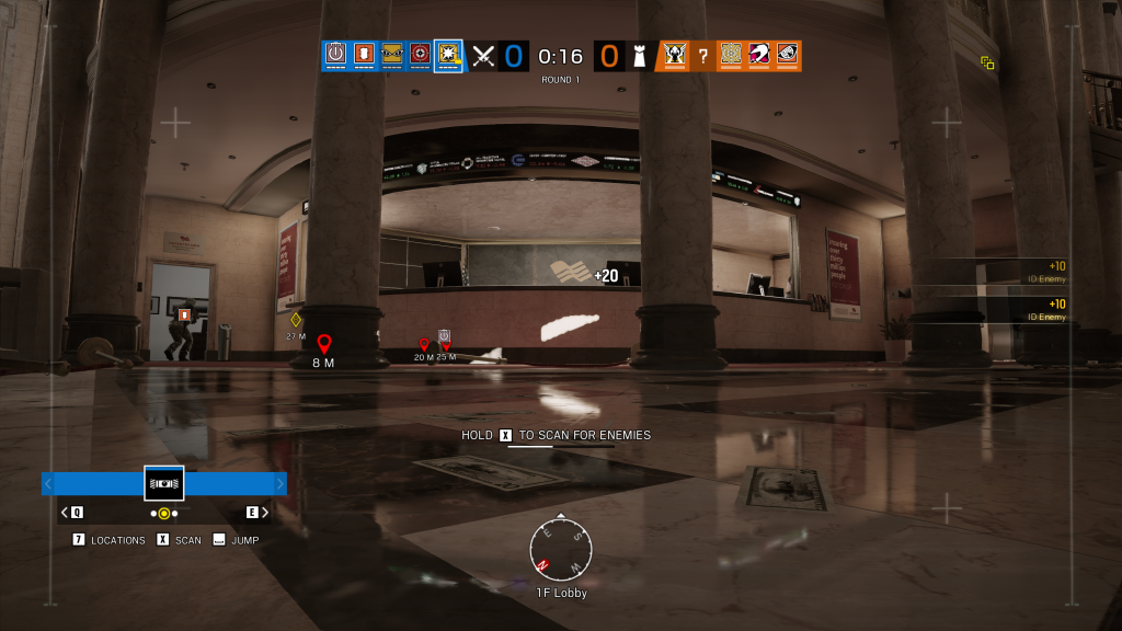 Screenshot showing a low wide angle view from a drone camera in a lobby of a large bank building. The input command reads Hold X to scan for enemies.