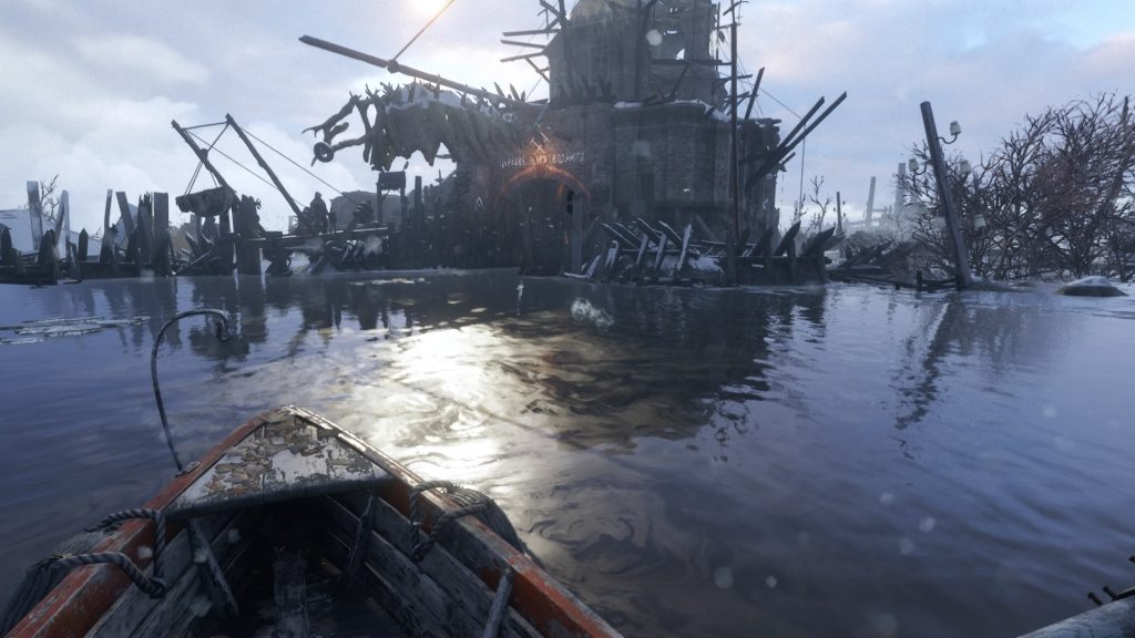 Screenshot showing a first person viewpoint on a row boat on water, rowing towards a crumbling building with defences around it.