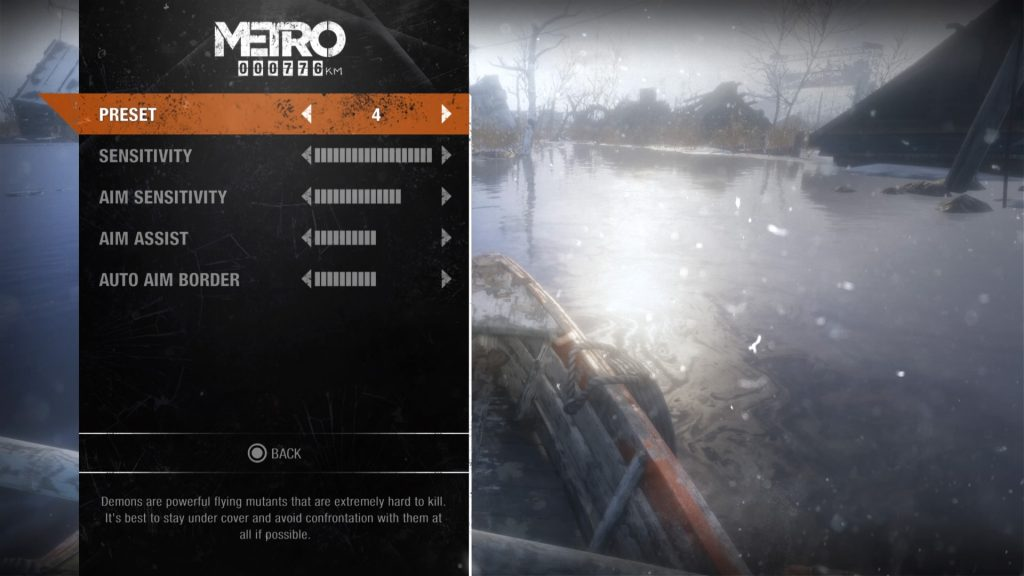 A screenshot showing settings including Sensitivity, Aim Sensitivity, Aim Assist and Auto Aim Border.