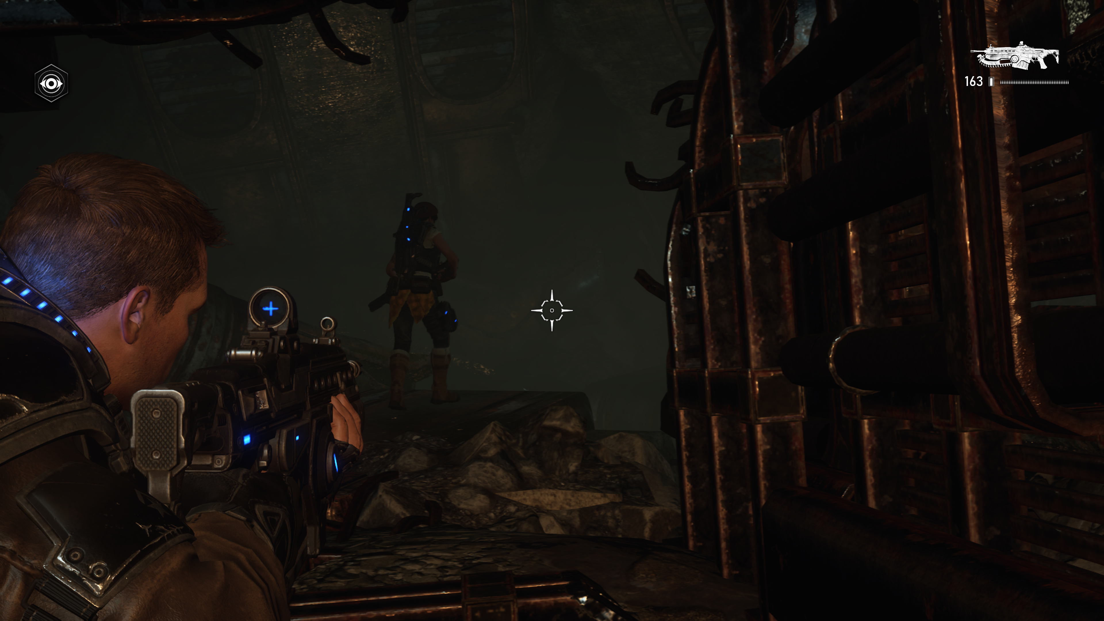 Screenshot showing a character looking down his sights in a dark corridor.