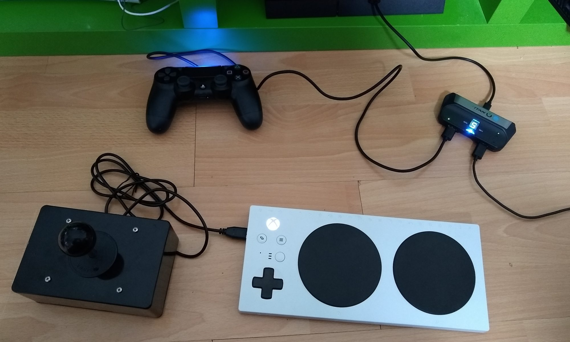 Xbox Adaptive Controller connected wirelessly to a Titan Two into a Playstation 4. With OneSwitch Ultrastik controller.