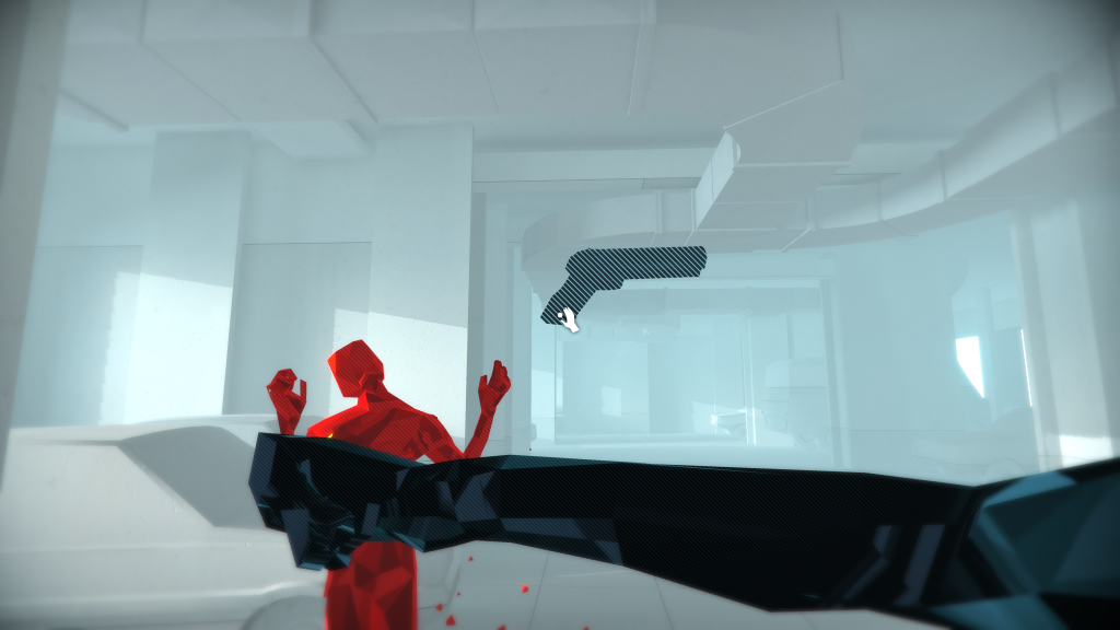 Screemshot showing a first person view with an outstretched arm having hit red digitalised AI. Apistol is flying through the air with a 'grab' icon over it.