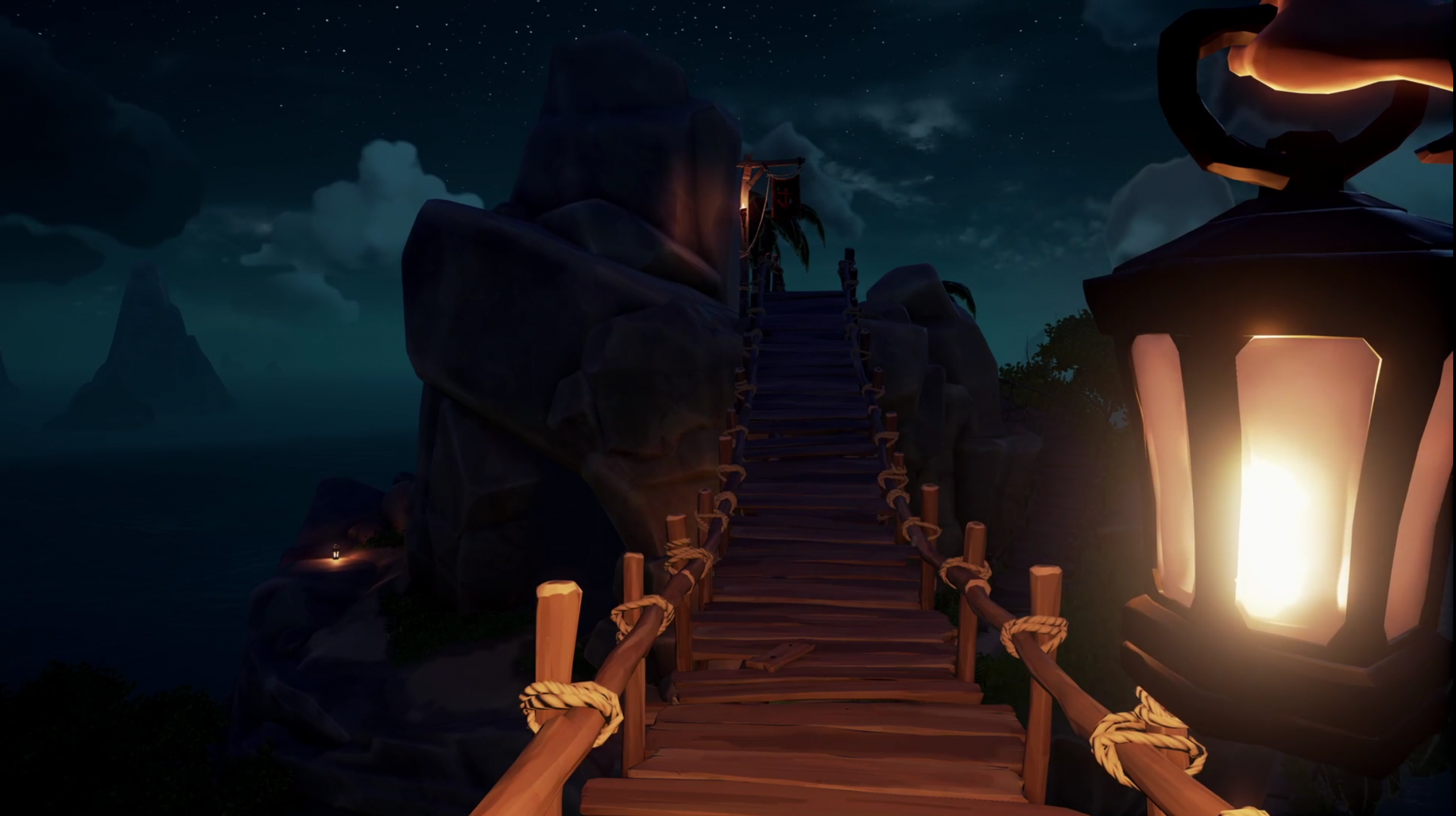 Screenshot showing a lamp being held in first person perspective whilst crossing a wooden bridge. Sea and islands can be seen in the background.