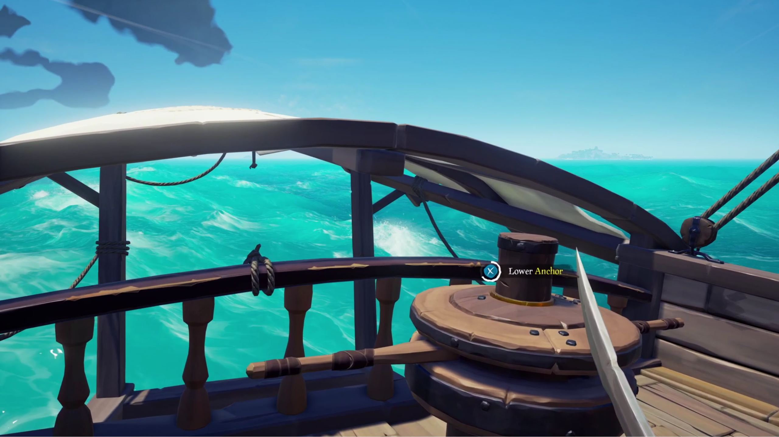 Screenshot showing an anchor mechanism on . ship deck with rolling sea behind.
