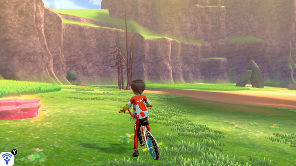 Screenshot showing a character in third person veiew of a bike.