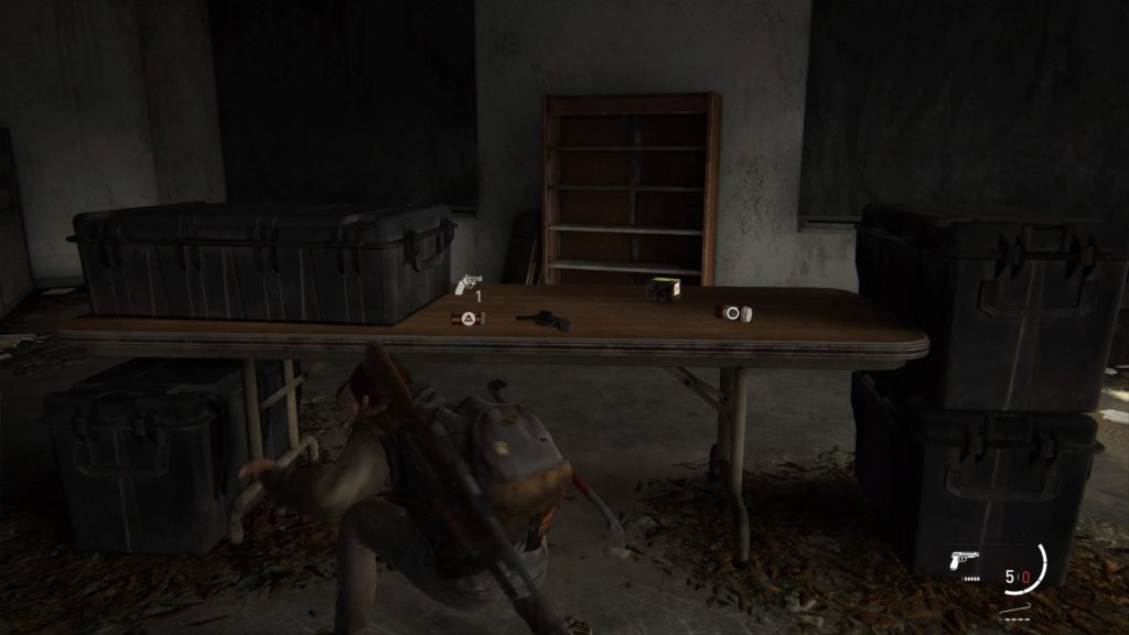 A screenshot showing Ellie picking items from a table.