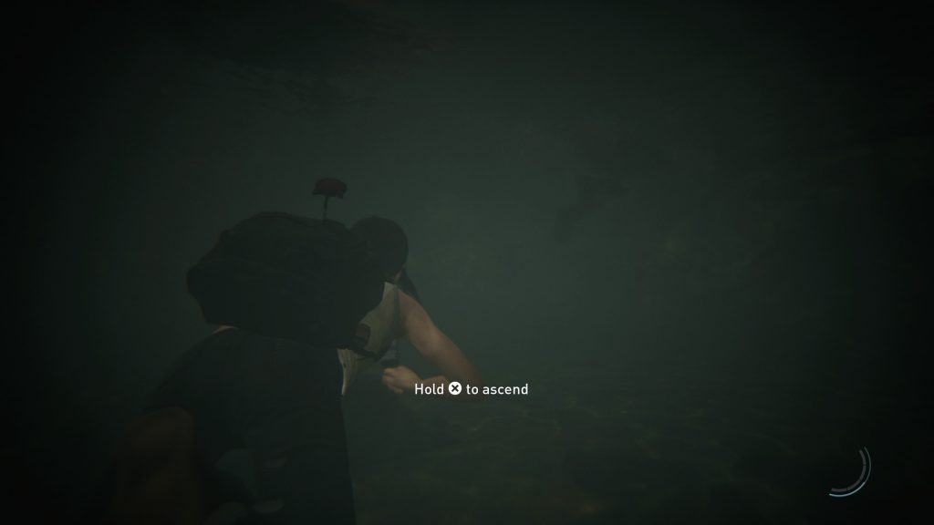 Screenshot showing Ellie swimming underwater with an onscreen prompt say Hold Cross to ascend.