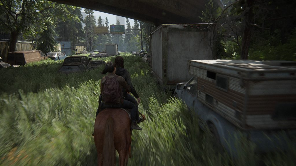 Screenshot showing Ellie and Dina riding on horseback through an overgrown street past abandoned cars.