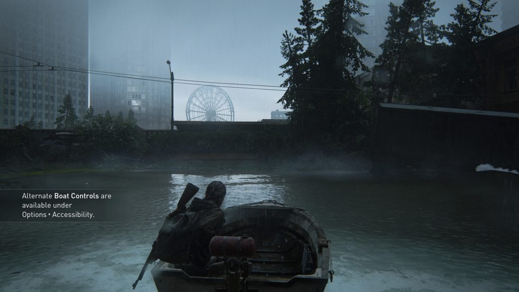 Screenshot showing Ellie in a boat with the onscren prompt letting the player know that alternate boat controls are available in the accessibility options.