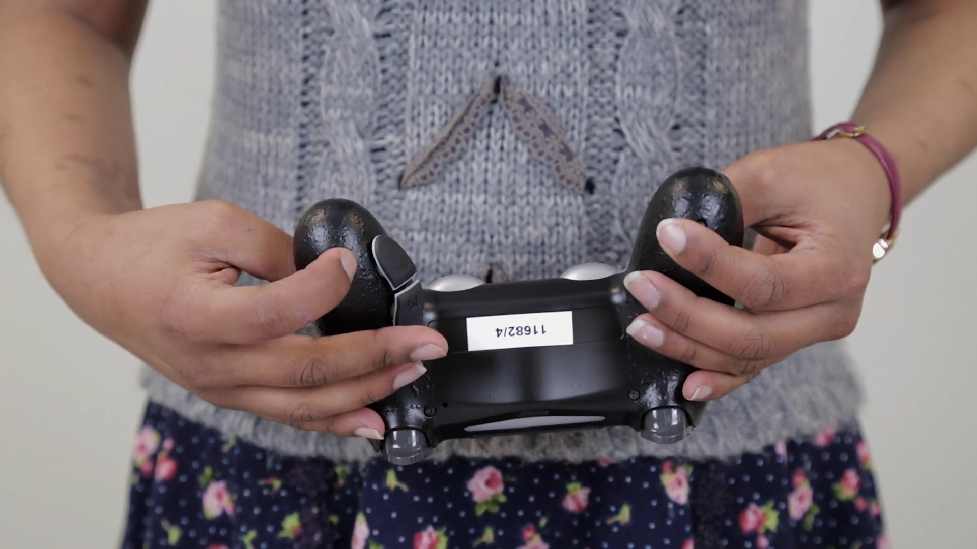 An Evil Lefty controller with the paddles being shown.