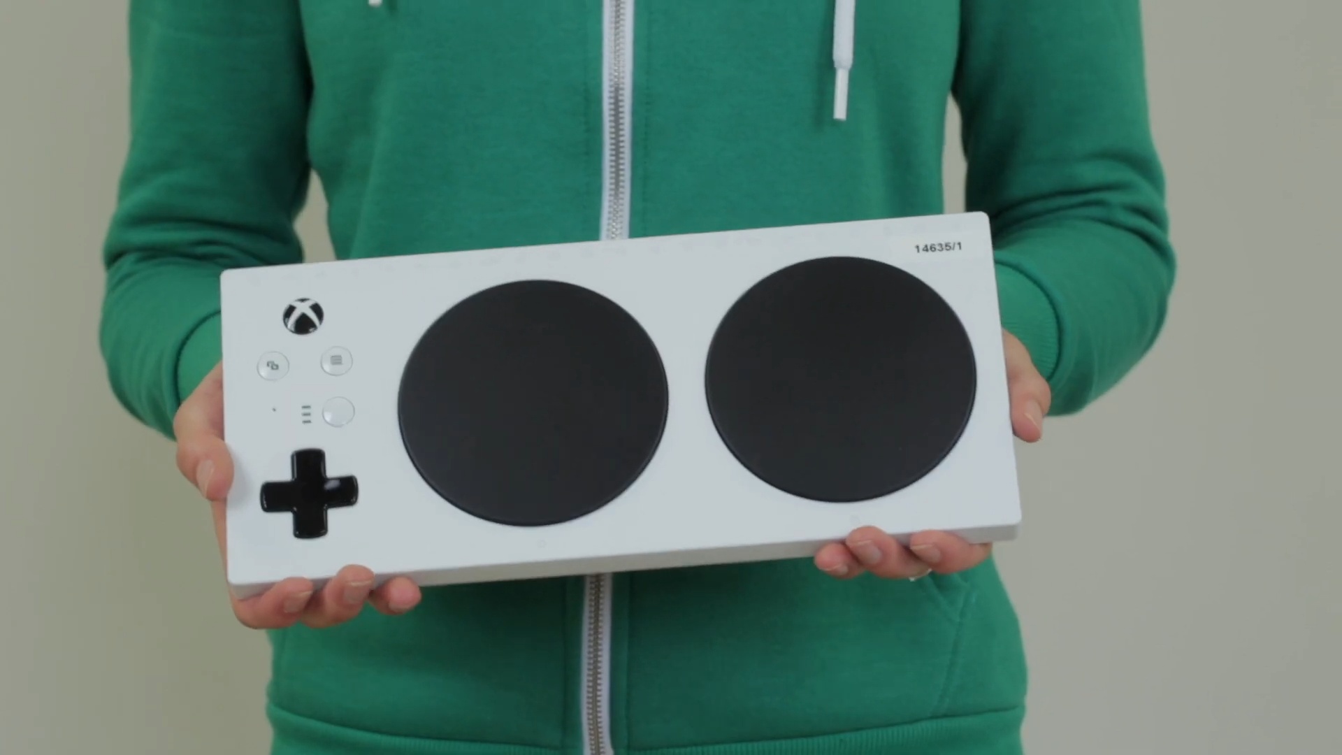 An Xbox Adaptive Controller being held.