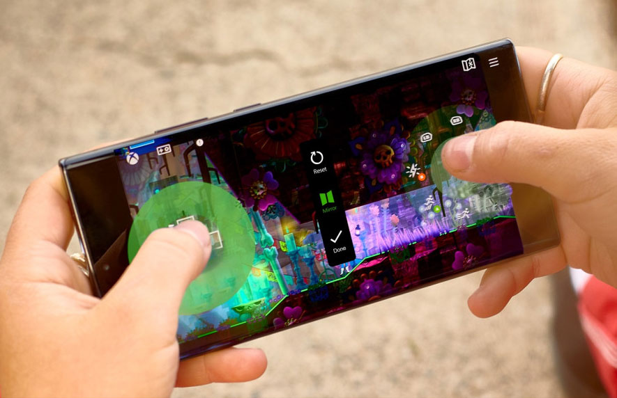 An Android phone with touch-screen controls being rearranged by the user for greater comfort.