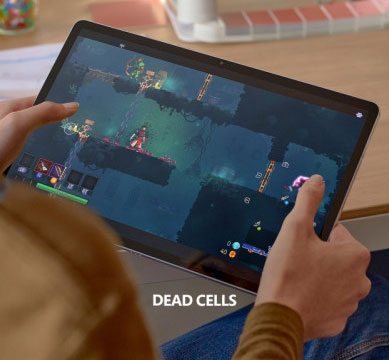 Someone holding a large tablet computer, with very small touch-screen controls. Text reads, Dead Cells.