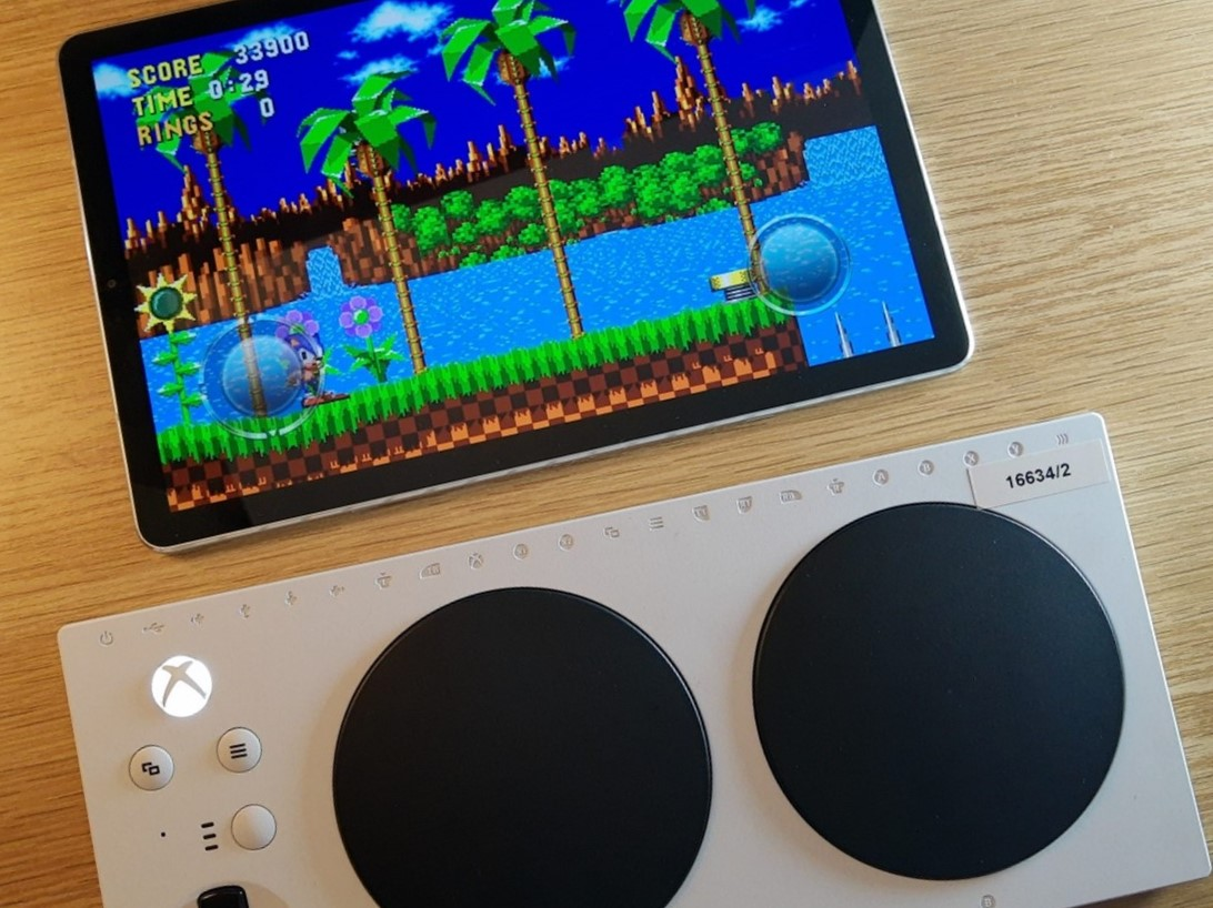 Photo showing an Android tablet with Sonic the Hedghog Classic running on it and an XAC next to the tablet.