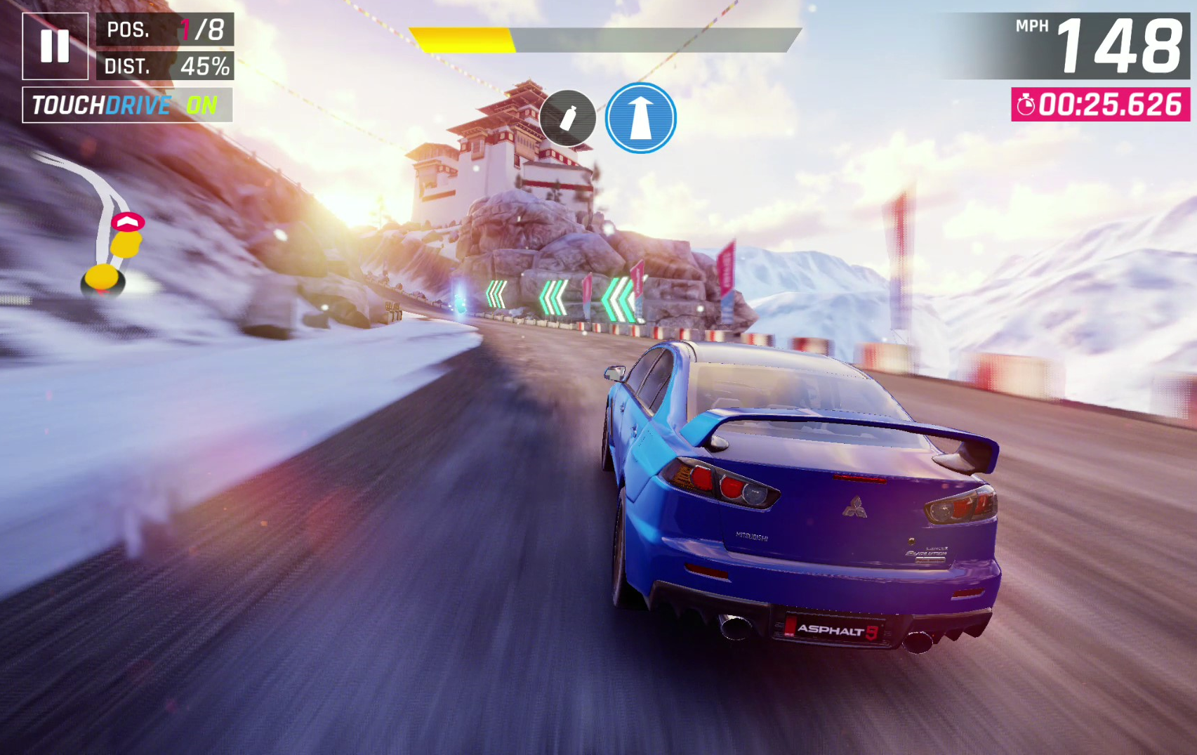 Screenshot of Asphalt 9 Legends showing vehicle approaching a turn at speed.