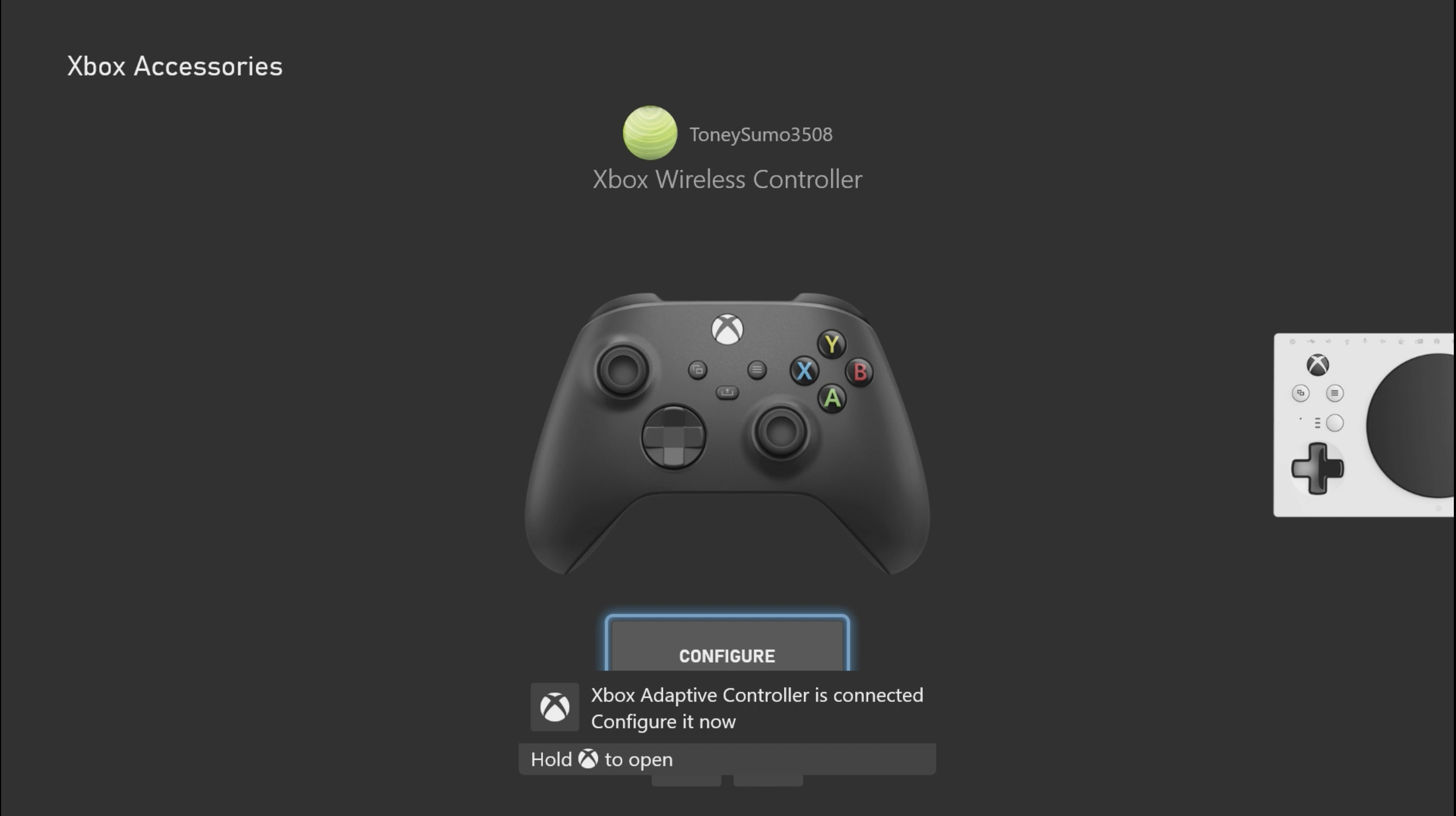 Screenshot showing a controller image within the Xbox Accessories app. An Xbox Adaptive Controller image is shown appearing at the side of the screen. A message stating 'Xbox Adaptive Controller is connected' is at the centre bottom of the screen.