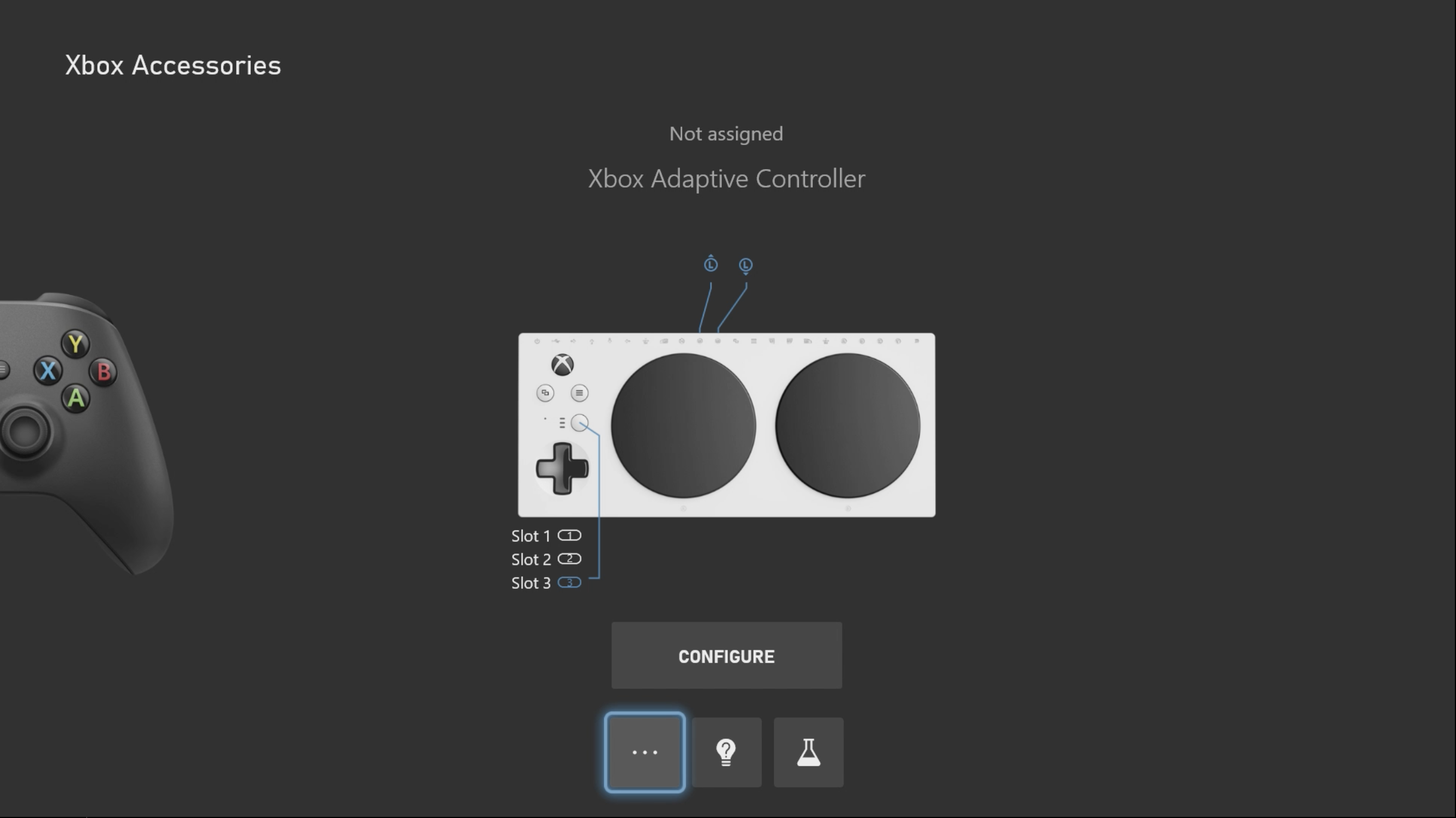 Screenshot showing an Xbox Adaptive Controller image within the Xbox Accessories app. A standard controller image is shown appearing at the side of the screen. An icon at the bottom of the screen with three dots is highlighted.