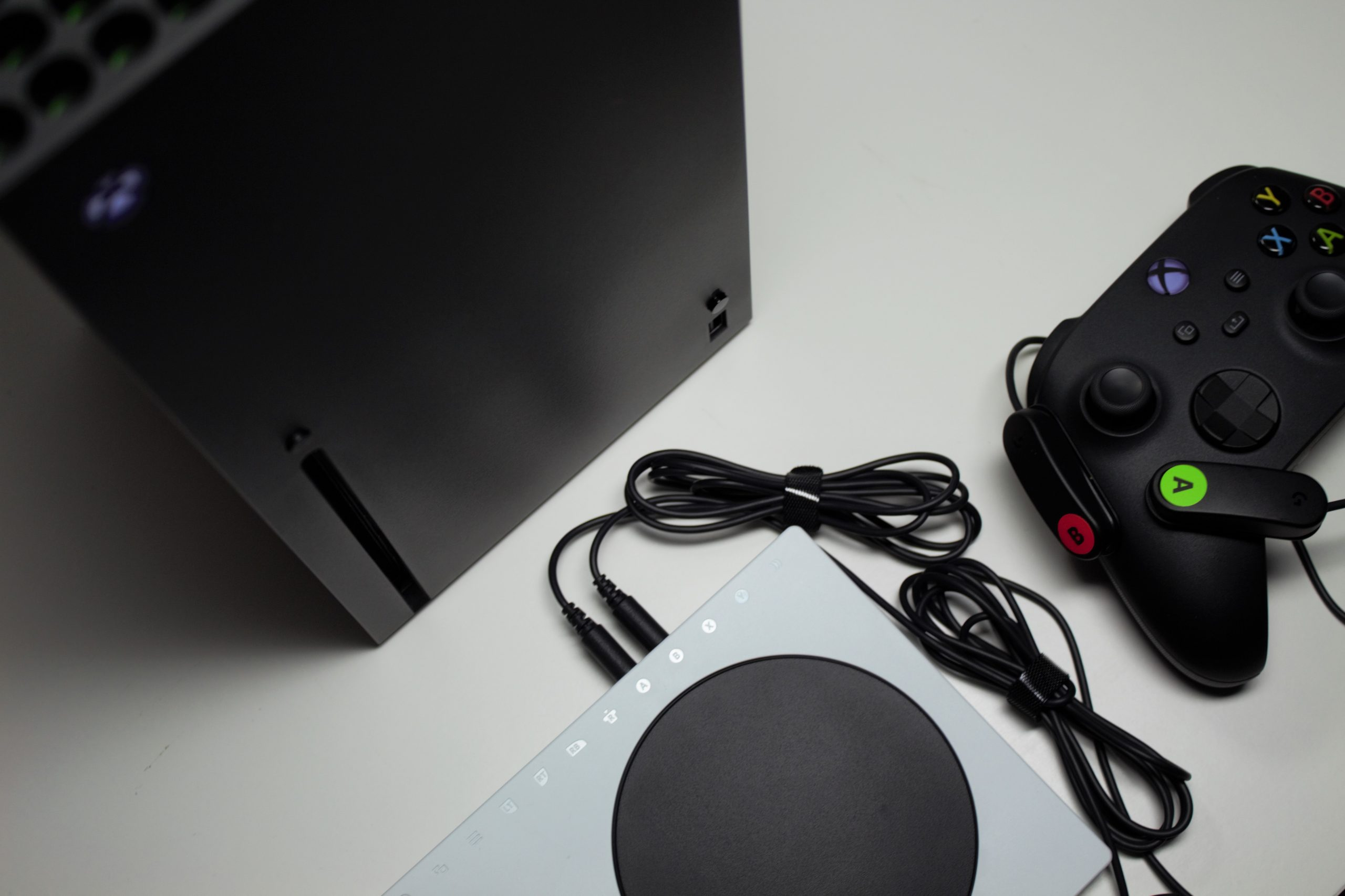 Photo showing Xbox Series X with an XAC and Standard Controller with two Logitech switches attached to the controller labelled A and B.