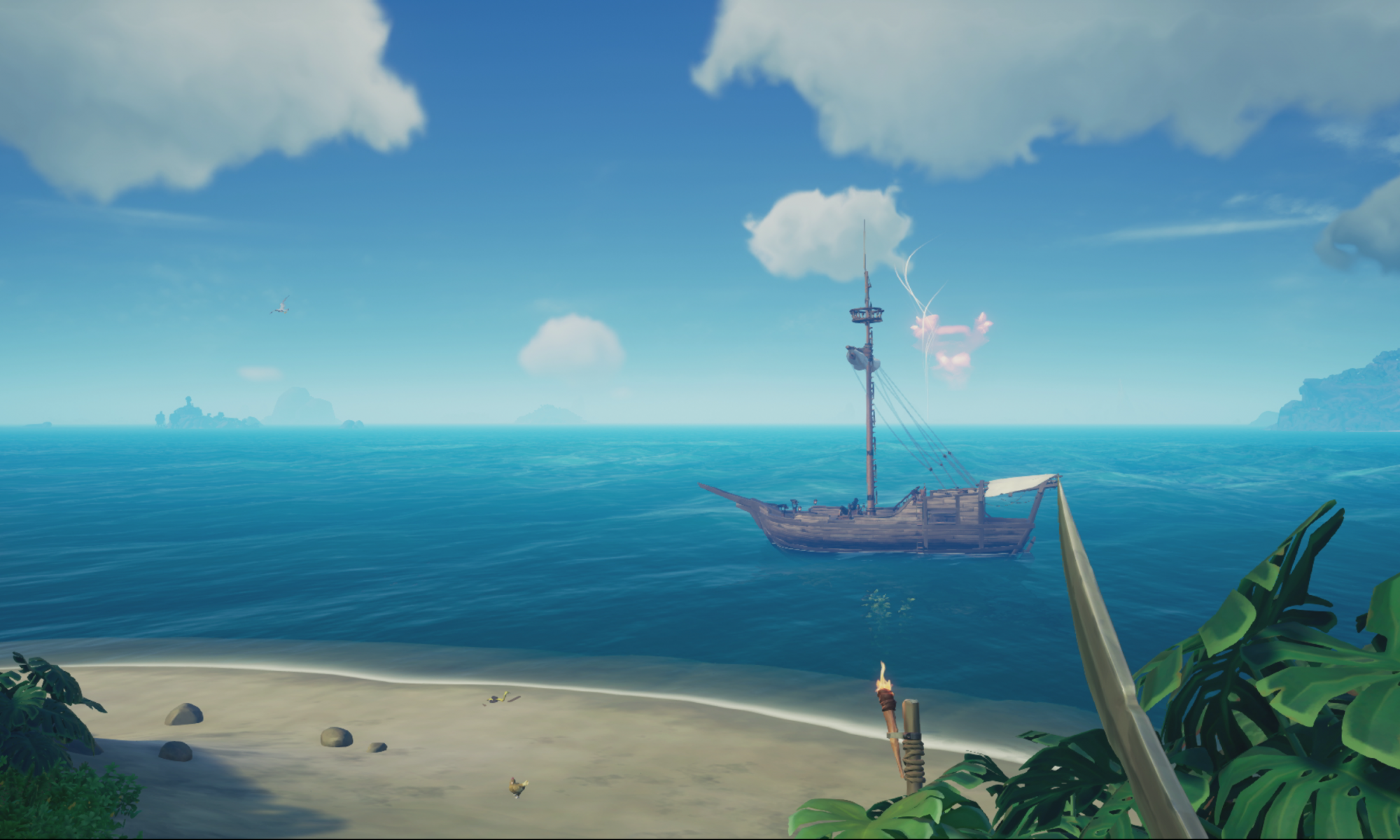 Screenshot showing a sloop ship at sea beyond a beach.