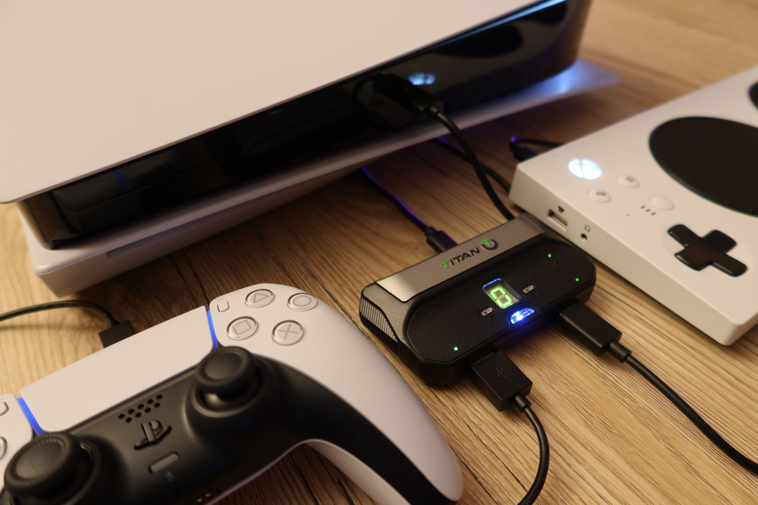 An image of a PS5 controller and an Xbox adaptive controller connected to a PS5 via a Titan Two