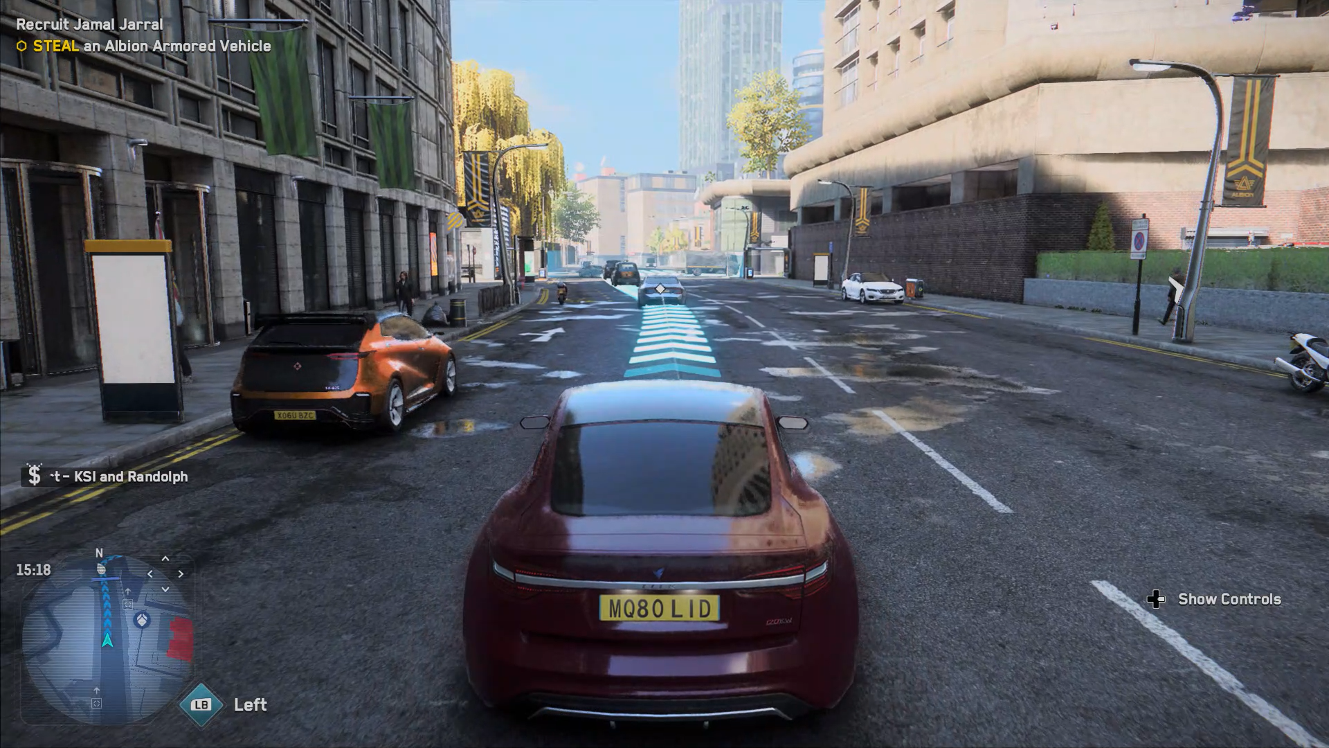 A screenshot demonstrating Autodrive in Watch Dogs: Legion. The player controller vehicle has a path or blue arrows leading the way ahead of it in the street.