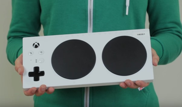 A photograph of an Xbox Adaptive controller being held.